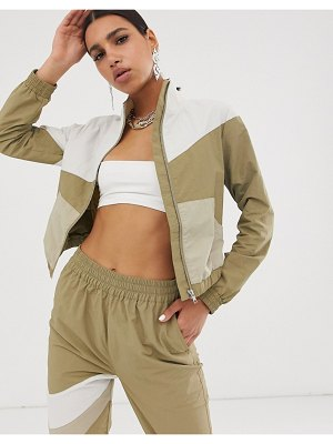 ASOS DESIGN cropped tracksuit jacket in khaki color block-navy