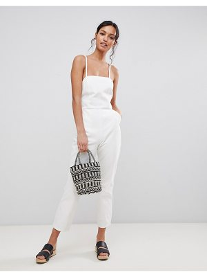 ASOS DESIGN denim halterneck jumpsuit in white