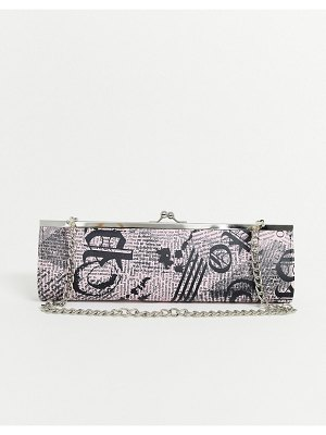 ASOS DESIGN elongated frame clutch in newspaper print-pink