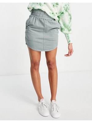 ASOS DESIGN jersey mini skirt with deep shirred waistband in washed sage-green