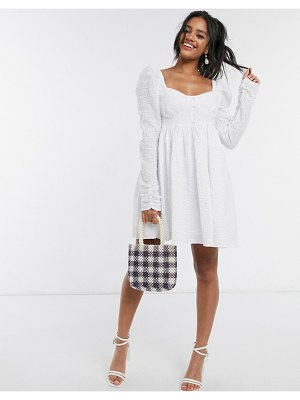ASOS DESIGN mini babydoll dress in texture in white