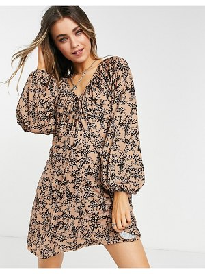 ASOS DESIGN mini smock dress with long sleeves and tie neck detail in animal print-black