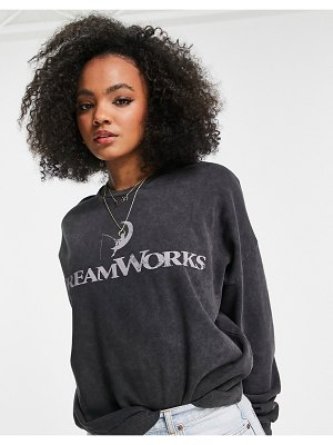ASOS DESIGN oversized dreamworks graphic sweatshirt in washed charcoal-grey