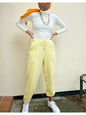 ASOS DESIGN oversized jogger with pintuck in lemon-yellow