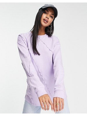 ASOS DESIGN oversized long sleeve t-shirt with exposed seam detail in lilac-purple