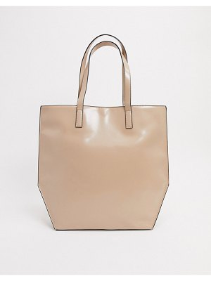 ASOS DESIGN oversized tote bag with reversed seams & contrast edges in neutral-beige