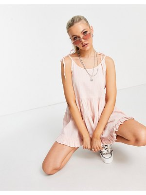 ASOS DESIGN textured trapeze tiered romper in blush-pink