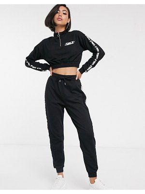 ASOS DESIGN tracksuit sweat with half zip / jogger with printed tape-black