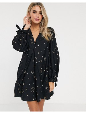 ASOS DESIGN v-front-and-back trapeze mini dress in star and moon embroidery in black