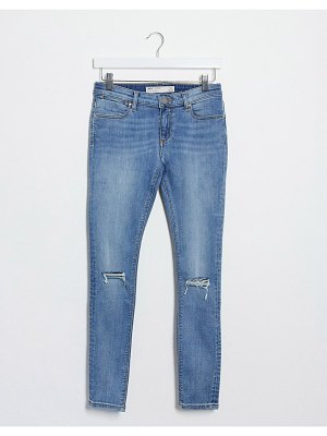 ASOS DESIGN whitby low waist skinny jeans in lightwash blue with rips