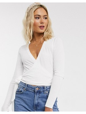 ASOS DESIGN wrap top in rib with long sleeve-white