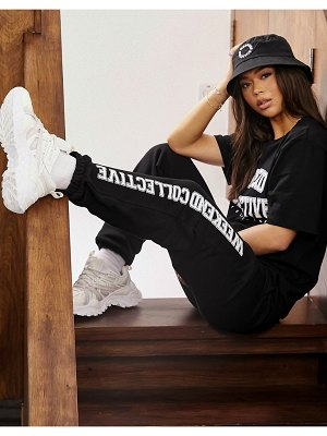ASOS Weekend Collective oversized sweatpants with varsity print in black