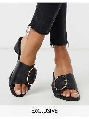 ASRA exclusive justice mules with statement buckle in black leather