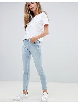 Calvin Klein high rise slashed skinny jeans-blues