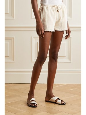 Caravana tunkaan leather-trimmed fringed cotton-gauze shorts