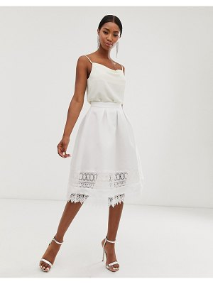 Chi Chi London midi skirt with cut out lace detail in white