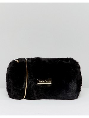 Claudia Canova soft faux fur cross body bag with zip top opening and metal detail