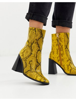 Co Wren square toe block heel boots in snake-yellow