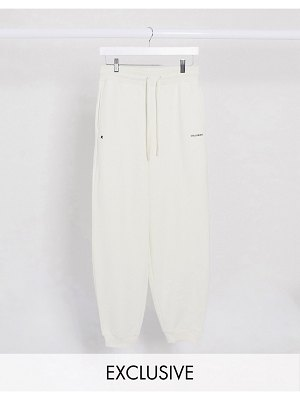 Collusion unisex oversized sweatpants with text print in cream