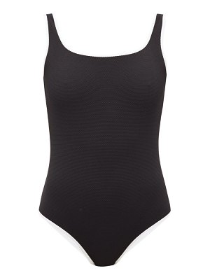 Cossie + Co the poppy reversible honeycomb-effect swimsuit