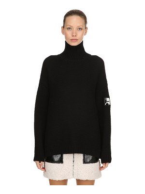 COURRÈGES Oversized wool turtleneck sweater