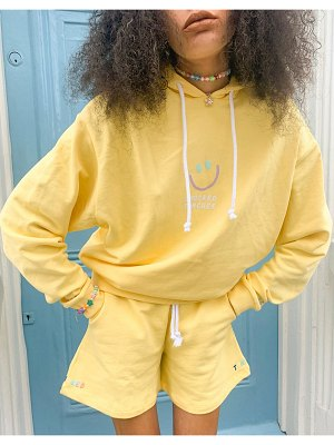 Crooked Tongues matching hoodie with logo in washed yellow