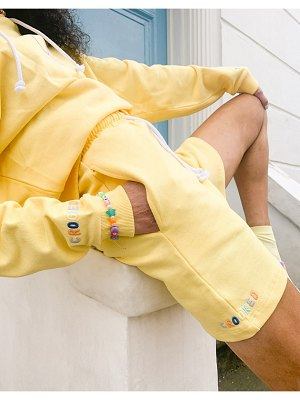 Crooked Tongues matching sweat shorts with embroidered logo in washed yellow