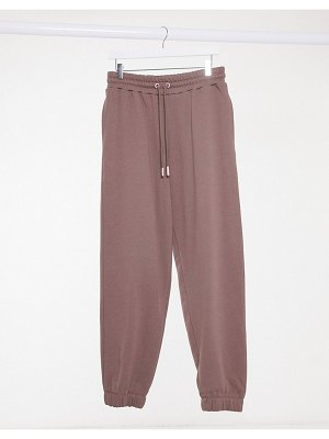 Crooked Tongues sweatpants in chocolate-brown