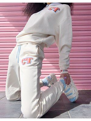 Crooked Tongues sweatpants with badge logo in ecru