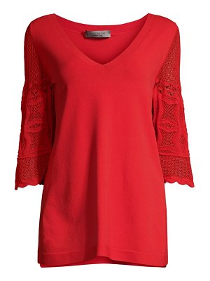 D. Exterior lace sleeve knit tunic