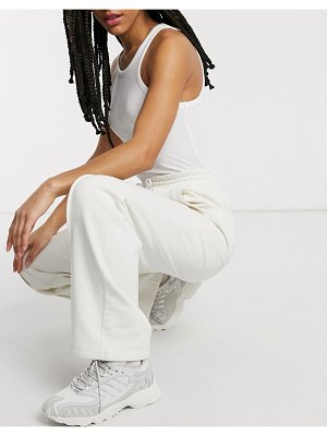Damson Madder straight leg relaxed pants with front seam & logo detail in recycled poly cotton-cream