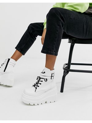 Demonia shaker double buckle chunky flatform boots in white