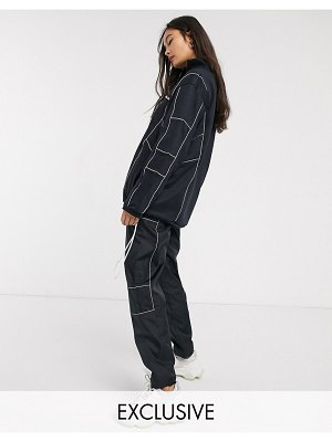 Ellesse wide leg tracksuit sweatpants with reflective piping two-piece-black