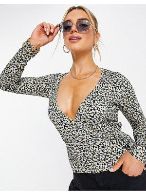 Envii ally long sleeve wrap blouse in multicolored whimsy print