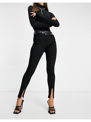 Femme Luxe skinny jeans with slit front in black