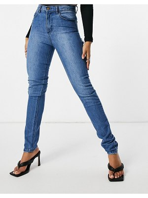Femme Luxe straight leg jean with distressed bum detail in mid wash-blues