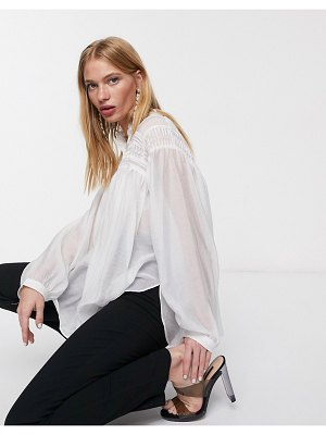 Ghospell oversized shirt with statement sleeves and pleated detail-white
