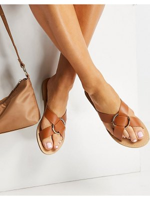 Glamorous cross strap flat sandals with gold ring in tan-brown