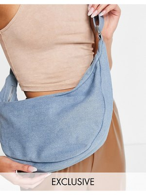 Glamorous exclusive curved sling tote bag in denim-blues