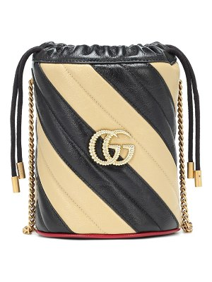 Gucci gg striped leather bucket bag