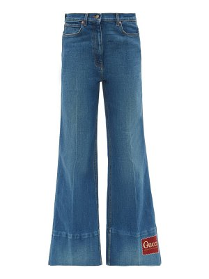 Gucci logo-patch high-rise flared-leg jeans