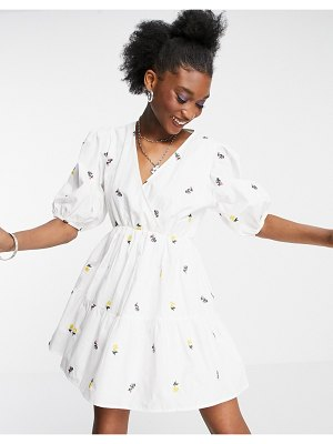 In The Style x lorna luxe wrap front tiered mini dress in white