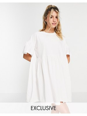 In The Style x olivia bowen exclusive smock dress with fluted sleeves in white