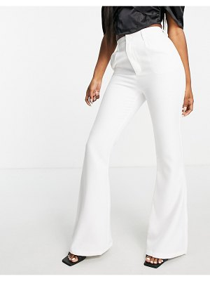 In The Style x yasmine chanel flare pants in white
