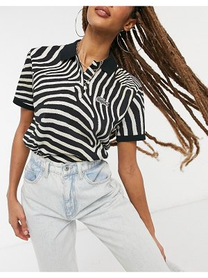 LACOSTE x national geographic polo shirt in zebra-black