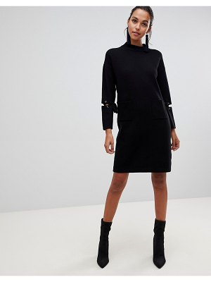 Liquorish long sweater dress with front pockets and lacing detail on sleeves