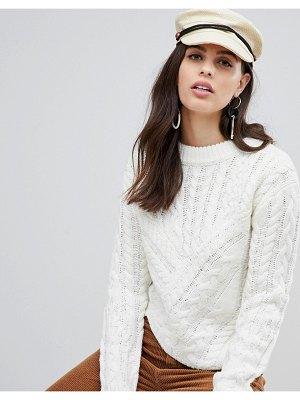 Liquorish round neck asymmetric cable knit sweater