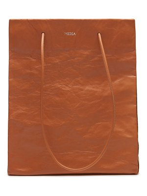 Medea tall busted leather tote