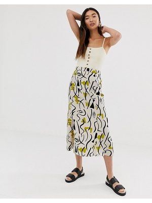 Monki abstract face print midi skirt in light beige