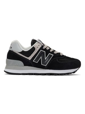 New Balance and white 574 sneakers